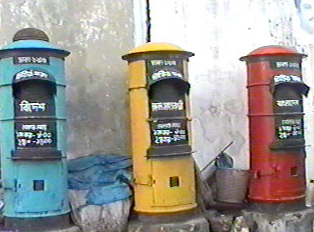 All three labelled post boxes next to one another