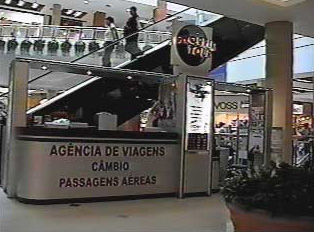 Travel agency and exchange bureau stand in a mall