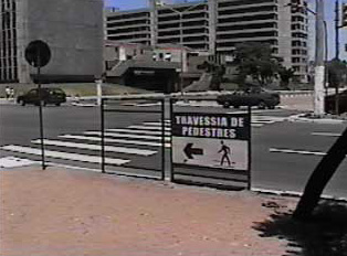 Sign: Pedestrians should cross on the crosswalk