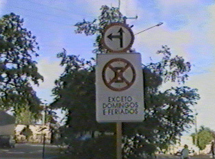 Top: go straight or left; bottom: no parking except Sundays and Holidays