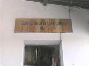 Sign for art gallery (in Portuguese and English)