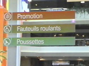 Directional signs for customer service inside a mall