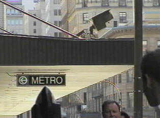 Sign marking the way to a Metro station