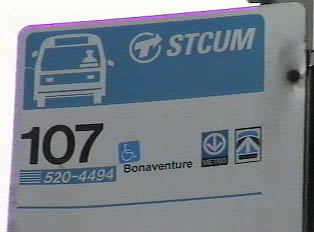 Bus stop signs include a bus number