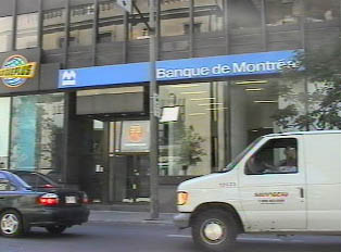Another bank in downtown with close-up of its ATM sign