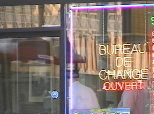 Exchange rate office with sign indicating it is open