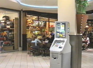 ATM  machine in a mall; cards that can be used with the machine