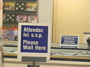Wait in line for service