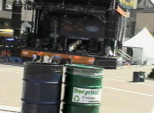 Newspaper and magazines; recycling box downtown during a street festival