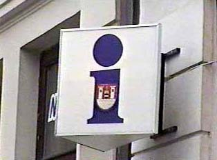 Sign with the town's emblem