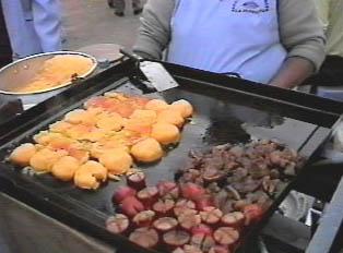 Llapingachos (potato and cheese tortillas) and pork