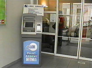 An ATM in front of a bank