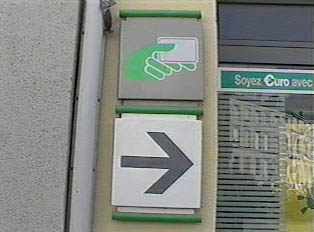 A sign for an ATM