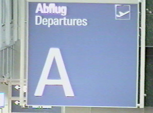 A sign for a departure terminal A