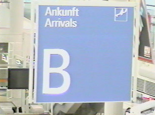 A sign for an arrival terminal B