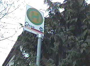A close-up of the sign for regional bus stop