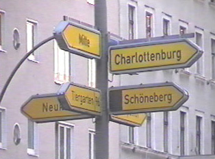 Yellow signs indicate cities or different districts within a city