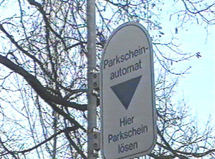 A sign for parking ticket machines
