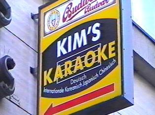 A sign for a karaoke bar