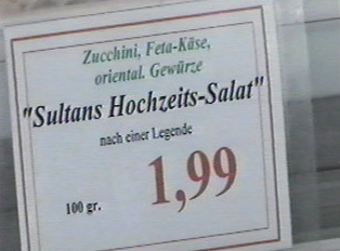 A price sign for a special salad made with zucchini, feta cheese and other ingredients