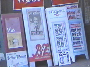 Boards showing the types of magazines for sale