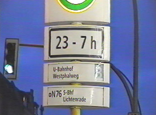 A close-up of the bus stop with operating hours displayed