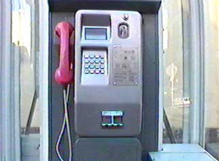 A public phone that uses coins