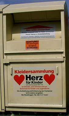 Close-up of clothing donation boxes