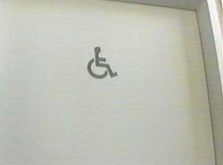 A sign for handicap accessible restroom