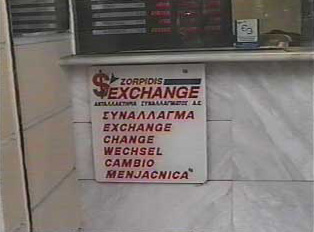 Money exchange sign in a variety of languages
