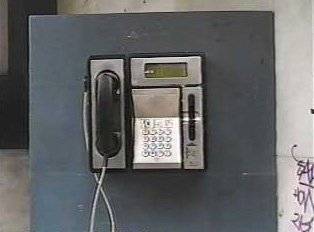 Close-up view of a public phone