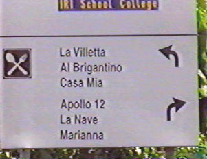 Road signs indicating directions for various restaurants