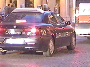 Police car displaying the 112 phone for the police