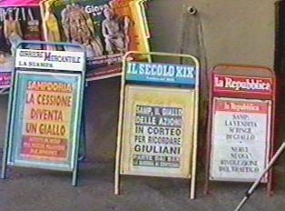 Advertisements at newsstand