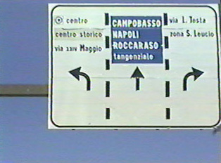 Highway signs including town exits