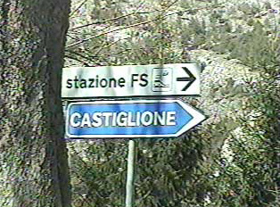 Directional signs to the train station and to the town of Castiglione