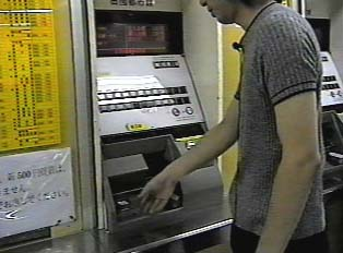 Taking a ticket from the machine