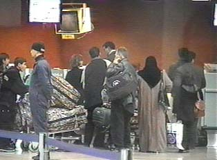 People waiting to check luggage and collect boarding passes