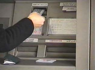 Inserting the card into the ATM machine