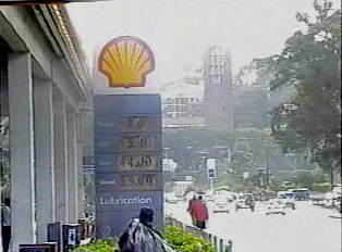 Billboard at gas or petrol station with price of gas on a per liter basis