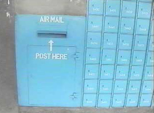 Post box slot and adjacent mail boxes