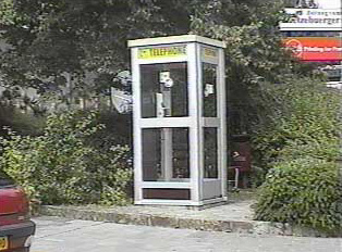 Gray public phone booth