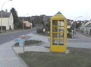 Yellow public phone booth