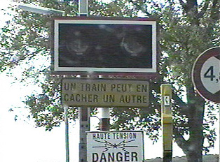 Close-up of signs at railway crossing