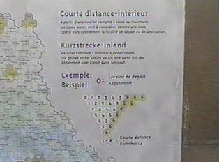 Close-up of sign for price per distance map