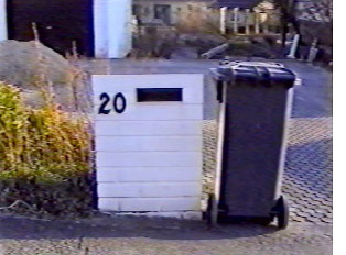 Trash bin, provided by the town for a yearly fee, is ready for pick up by the town trash contractor.