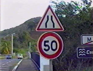 Road narrows, speed limit 50 kilometers per hour