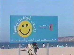 Sign in French and Arabic urging care for the beach environment