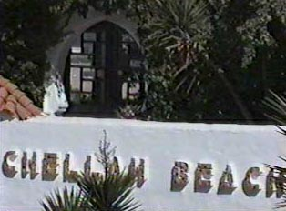 Beach and beach club sign