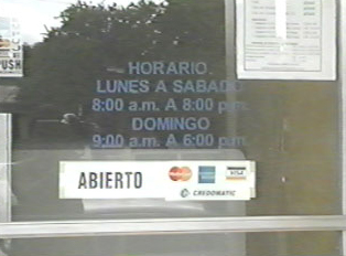 Doorsign with opening hours for an internet cafe
